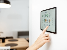 woman using tablet with smart home technology software